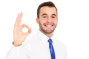 Happy businessman showing ok sign