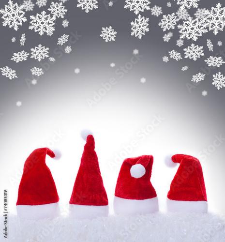 canvas print picture Weihnachtsmützen, Nikolausmützen und Schneeflocken