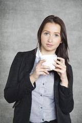 Serious business woman drinking coffee