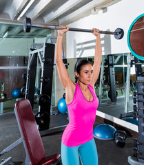 brunette narrow grip barbell shoulder press
