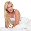 Young woman in bed isolated