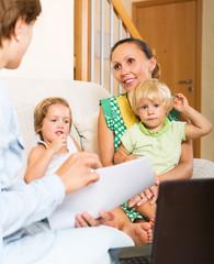 Satisfied mother arranging mortgage details