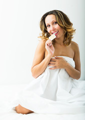 middle-aged woman showing contraceptive