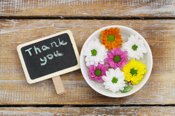 Thank you written on little blackboard with santini flowers