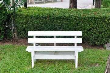 Single white bench in garden for relaxing.