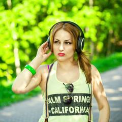 Beautiful girl listening intently to music on headphones