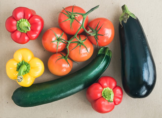 Vegetable set: ripe tomatoes, paprika, zuccini and an aggplant o