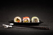 Leinwanddruck Bild - Luxurious sushi on black background - japanese cuisine
