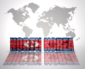 Word North Korea on a world map background