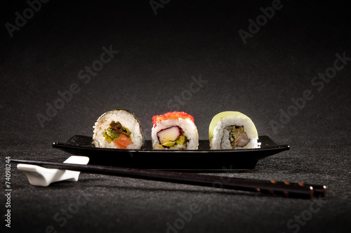 Poster Restaurant Luxurious sushi on black background - japanese cuisine