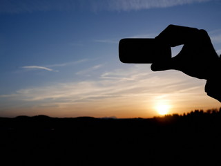 smartphone hand sunset