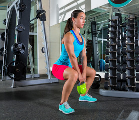 goblet kettlebell squat woman workout at gym