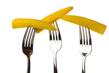 Three ear of corn on a fork