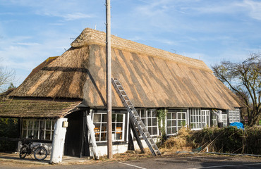 Thatch roof being renewed on an old building