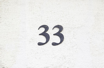 Number thirty-three on the wall of a house