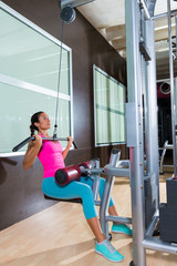 Lat pulldown machine woman workout at gym