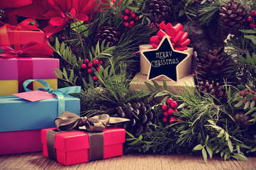 gifts, christmas wreath and text merry christmas in a star-shape