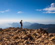 tourist woman on the top of mount,