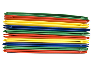 Stack of Vibrantly Colored Plastic File Folders