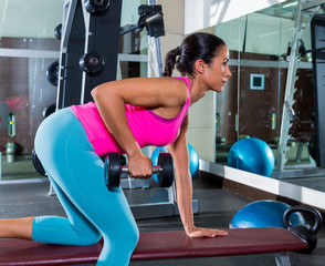 girl one arm dumbbell bent over row workout