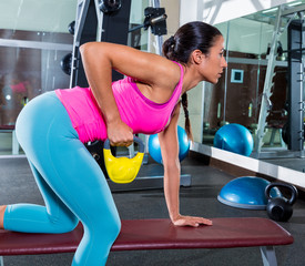 girl one arm kettlebell bent over row workout