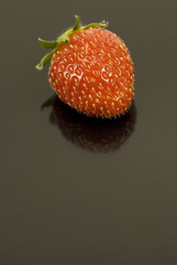 Strawberry On Black Reflective Background