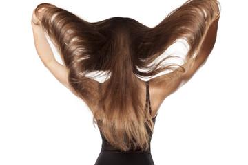 young woman shows her long beautiful hair