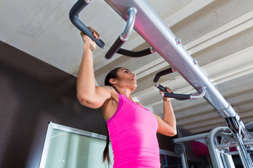 Pull ups Pull-up exercise workout girl at gym