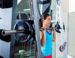 brunette girl in multipower barbell Smith machine
