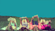 Leinwanddruck Bild - friends reading under sunshine lying on the meadow