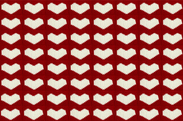 knit white hearts of the warm woolen threads