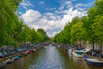 City view of Amsterdam canal with boats, Holland, Netherlands.
