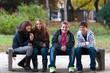 Four teenage friends having fun in the park