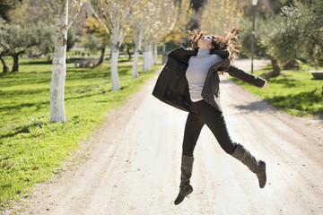 Woman jump on the road