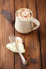 grated chocolate with hot chocolat vintage mug, topping with cre