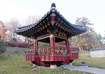 Ornate chinese pavilion in autumn park