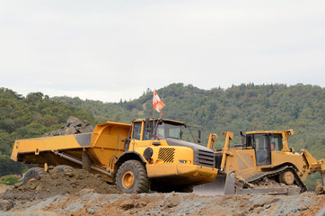 Large bulldozer leveling out fill at a airport runway
