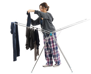 Red haired girl drying clothes on clothesline isolated