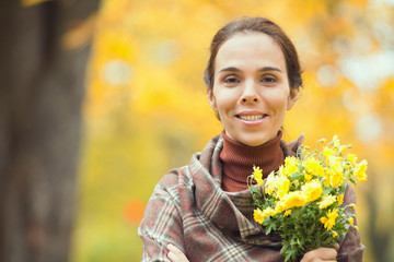 Portrait of a beautiful woman holding a bouquet