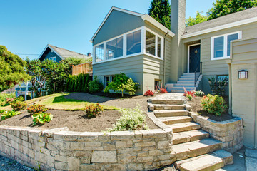 Front yard landscape with stone trim. House exterior