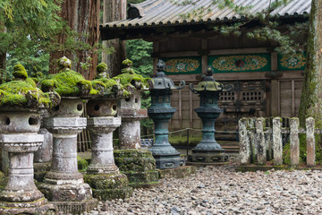 moss covered stone lanterns at Nikko Tosho-gu