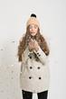 Obrazy na płótnie, fototapety, zdjęcia, fotoobrazy drukowane : Cute young woman blowing confetti. No retouch.