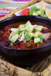chili con carne bowl with avocado topping