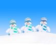 Leinwandbild Motiv Happy winter snowmen family against blue sky