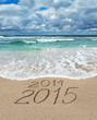Happy New Year 2015 wash away 2014 concept on sea beach