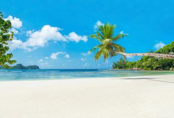 Tropical beach Baie Lazare with boat, Mahe island, Seychelles