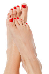 Female feet with red nails