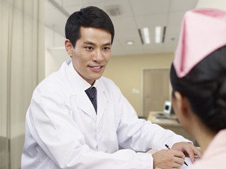 doctor and nurse talking in office