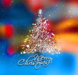 Christmas tree in the blur background with space for text