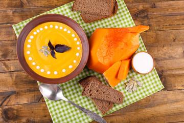 Pumpkin soup in color plate and pumpkin slice